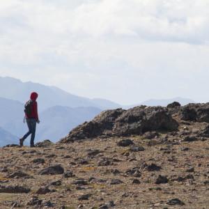 Kir hikes along the summit of Flattop Mountain